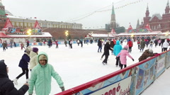 People sitting on the rink on Red Square Stock Footage