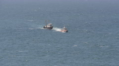 Coast guard rescue - ship under tow at sea Stock Footage