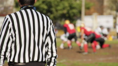 Active football game begins on gridiron, players working hard to score points Stock Footage