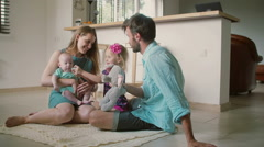 Beautiful young family: mum, dad, little daughter and baby son are sitting on Stock Footage