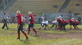 Rival team players using force to tackle opposing ball carrier, violent attack HD Footage