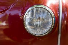 Retro car parade headlamp - stock photo