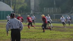 Active players and referee running fast on gridiron, American football match Stock Footage