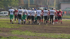 Break in American football match, opposing teams changing sides of gridiron Stock Footage