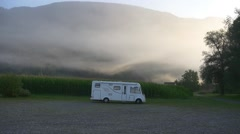 Camping caravan in front of the mountain Stock Footage