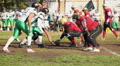 Strong football players brawling for ball during game, risk of sport injuries HD Footage