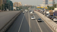 Summer city view from bridge over multiband road, living houses, traffic jam Stock Footage