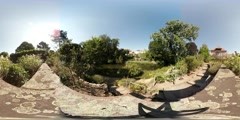 360 VR Botanic garden with roses blue sky and river Stock Footage
