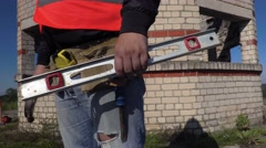 Construction worker with metal Cutting shears and mounting tape Stock Footage