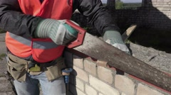 Construction worker using handsaw Stock Footage