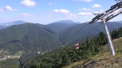 Mountain landscape background, cableway go down foothills place cable car moving Stock Footage