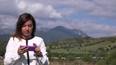 Angry latina business woman tapping smartphone touch screen in nature outdoor 4K Stock Footage