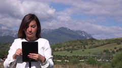 Portrait of latina business woman using digital tablet outdoors in nature 4K  Stock Footage