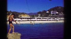 1952: Man diving swimming beach area cabanas blue ocean boldsky. ACAPULCO, Stock Footage