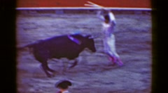 1948: Classic torero bullfighter ninja stabs doomed bull with swords running.  Stock Footage