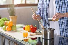 Guy preparing healthy food at home Stock Photos