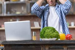 Puzzled guy cannot prepare food Stock Photos