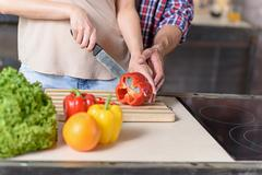 Loving couple cooking healthy food Stock Photos