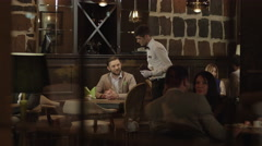 4K Man making an order and waiting in the restaurant. Stock Footage