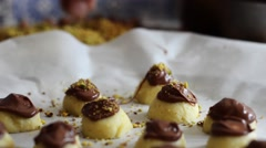 Authentic chocolate making by skilled artisan chef, sprinkling confectionery Stock Footage