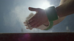 4K Sportsman chalking his hands before performance . Slow motion. Stock Footage