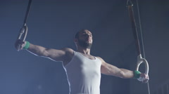 4K Gymnast performing gymnastic cross exercise on gymnastic rings. Stock Footage