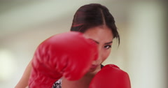 Japanese woman boxer throwing punches Stock Footage