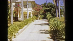 1953: Wealthy villa plantation estate home tropical banana republic owners. SAN Stock Footage