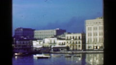 1953: Calm glassy waters on urban bayside waters classic buildings community.   Stock Footage