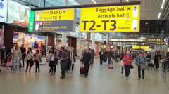 People walking and rushing to gate at Departure Hall Schiphol July 30th Stock Footage