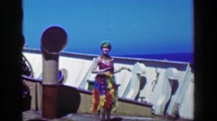 1953: Gypsy girl hula performer dancing weird cruise ship deck actor Stock Footage