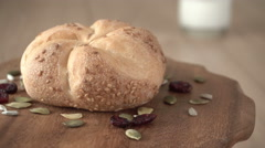 Freshly baked pastry rotating on a wooden board Stock Footage