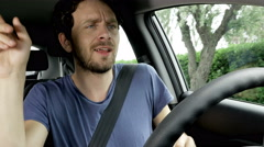 Funny geeky man in summer dancing in car while driving 4K Stock Footage