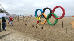People posing in front of Olympic Rings at Copacabana beach in Rio 4k Stock Footage