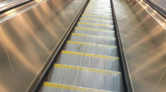Riding down escalator point of view Stock Footage