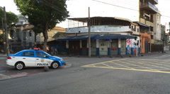 Police sitting at corner of intersection in Vila Isabel Rio de Janeiro Brazil Stock Footage