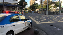 Policia in Rio de Janeiro town of Vila Isabel at intersection 4k Stock Footage