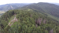 The mountain ridge covered with forest with flag. Stock Footage