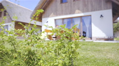 Beautiful retro house with shrub growing in front 4K Stock Footage