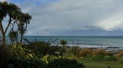 New Zealand Kaka Point cloud over sea pan Stock Footage