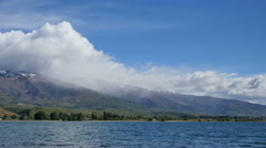 New Zealand Lake Dunstan with cloud and rain pan Stock Footage