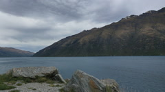 New Zealand Lake Wakatipu with grey cloud pan Stock Footage