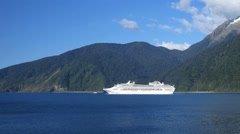 New Zealand Milford Sound cruise ship in Tasman Sea Stock Footage