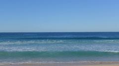 Surfers Surfing in Australian Beach Stock Footage