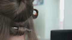 Stylist makes curls brown-haired using a curling Stock Footage