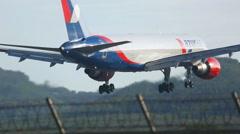 Boeing 757 landing at Phuket airport Stock Footage