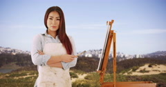 Asian woman artist standing in the countryside Stock Footage