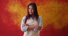 Japanese woman artist standing in front of backdrop Stock Footage