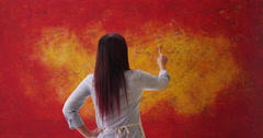 Japanese woman painting wall Stock Footage