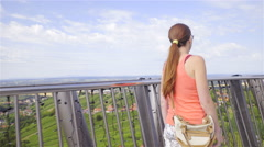 Woman walk around tower with view of nature flat landscape 4K Stock Footage